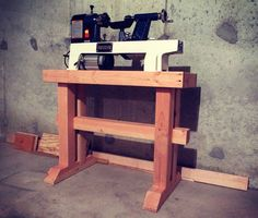 Lathe Stand -- Substantially less ad hoc than my own, though I'd like more ballast or anchoring options to reduce vibration for my larger setup.
