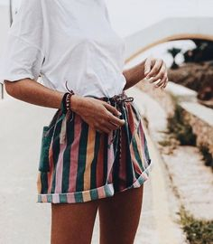 Big Stripe shorts with elastic and tie string, white shirt with the same attitude! Perfect to accessorize  Style Olia