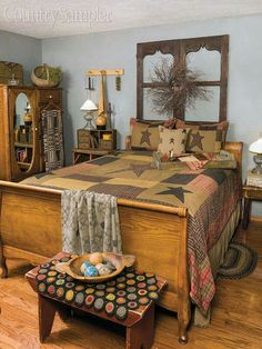 Country Sampler magazine  -  What's your favorite thing in this cozy prim bedroom? We can't decide!  For more info about some of the items seen here, check page 66 of our January 2016 issue. ♡I love the door frames at the head of the bed♡