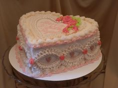 Heart shaped sour cream white cake covered in cherry flavored butter cream. Embellished with fondant hearts and pearls, and butter cream ruffles and roses. Heart Shaped Birthday Cake, Pretty Birthday Cakes, Heart Shaped Cakes, Pretty Cakes, Beautiful Cakes, Amazing Cakes, Cake Birthday, Desserts Sains, Cute Desserts