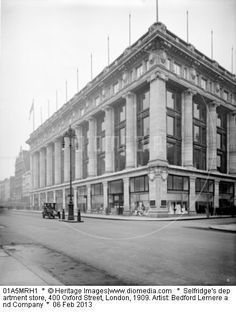Selfridge's Department Store, 400 Oxford Street, London. Selfridge's was founded by Harry Gordon Selfridge and opened in March 1909. It is a huge Ionic structure, designed by Daniel Burnham of Chicago. Just a single motor vehicle is driving past.