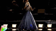 "Carrie Underwood's grey dress turned into an animated light show during her performance of ""Two Black Cadillacs"" at the 55th Grammy Awards on Sunday night."