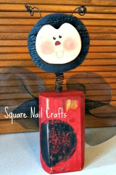 Timber ladybug created and painted by Square Nail Crafts adapted from a Debbie Bryan design.