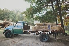 Old Studebaker with our homemade apple butter on it , as the favors. Homemade bunting hanging on the truck, along with bales of hay to stack the jars on. #studebaker #rusticwedding #diywedding #vintagewedding #tealwedding #Fallwedding #octoberwedding #outdoorwedding #hotmetalstudio
