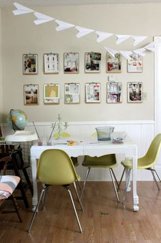 Love the paper airplane garland, love the clipboard display, love the lime green chairs!!