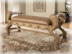 """Old World Traditional Leather Bench by Famous Brand Furniture. $468.65. Distressed bisque finish. 100% leather upholstery. 51"""" W x 20"""" D x 23.38"""" H. Old World style.. Ornate decoration. Add a touch of splendor to your room with this gorgeous bench from the South Coast collection. Features a distressed bisque color with 100% leather upholstery and ornate hand applied decoration throughout. Matching pieces available. May require assembly.. Save 19%!"""