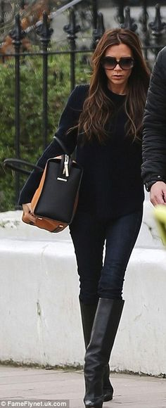 slouchy sweater  skinny jeans  big boots - say what you want about VB but she's got style! :-)