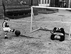 A boy playing soccer with a...panda bear??? Hahahahahahahahahahahaha