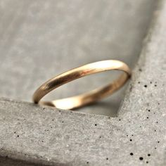 Women's Gold Wedding Band, 2mm Half Round Slim Recycled 14k Yellow Gold Ring Brushed Gold Wedding Ring - Made in Your Size by TheSlyFox on Etsy https://www.etsy.com/listing/113654612/womens-gold-wedding-band-2mm-half-round