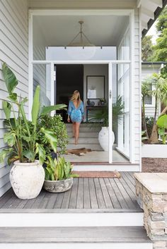 Outdoor Idea. Paint my timber a white/grey wash. Love this entrance with its breezy welcoming feel. Also the oversized pot plants and concrete internal stairs.