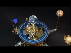 An orrery is a mechanical model of the heliocentric solar system illustrating the relative positions and motions of the planets and moons. This one was made by Ken Condal from brass, aluminum, acrylic, corian and exotic woods Solar System Model, Machining Process, China Map, Space Themed Nursery, Cnc Projects, Space And Astronomy, Deep Space, Retro, Decoration