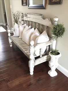 Farmhouse design, distressed furniture, light color palette, dark flooring, entry styling, throw pillows