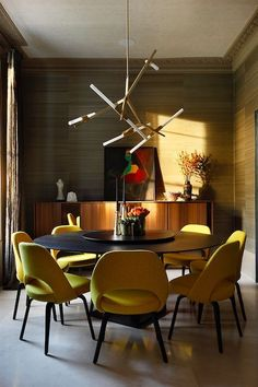 Carden Cunietti Interior Design Heroes | The Maker Place. A stunning mid century modern inspired dining room with chartreuse green velvet dining chairs and round table. See more inspirational rooms from the same home in our latest interior designer interview.