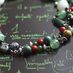 Gorgeous green malachite adds extra elegance to this stunningly beautiful necklace.   Handmade from red and green stones and glass beads, this necklace is a one-off.   Buy it now and be the proud owner of this special creation!