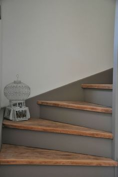 Stair treads left bare wood, waxed, risers painted in stormy grey, clean line on the wall.: