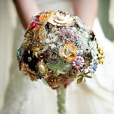 Lovely vintage wedding with a brooch bouquet and fabulous dress by Tina Sargeant