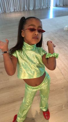 """The holographic high-neck crop top and trousers North West wore to her Saint West and Reign Disick's joint birthday party were identical to the ones worn by Selena Gomez in DJ Snake's """"Taki Taki"""" music video. Estilo Kardashian, Kourtney Kardashian, Kardashian Family, Kardashian Style, Kardashian Jenner, Kardashian Memes, Kris Jenner, Kendall Jenner, Kylie"""