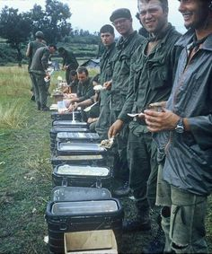 Vietnam and Hot chow. My husband, a Vietnam Vet, said the soldiers pictured here are the ones that served the hot meal. He also said at the beginning of the line there were boxes of hand grenades and M-16 ammunition for the soldiers to stock up on.