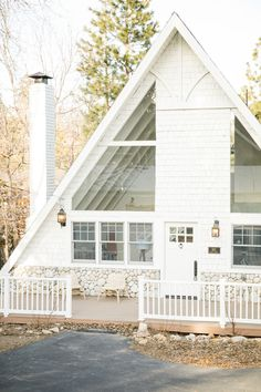 This All-White A-Frame Cabin Mixes Rustic and Scandi-Modern, and It's Dreamy White Cabin, A Frame House Plans, Lake Cabins, Plantation, Cabin Homes, Cabins In The Woods, House Tours, Sweet Home, House Design