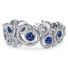 Some inspiration not only for St. Valentine's shoppers: This handcrafted platinum bracelet by Omi Privé features 15.09 cts. t.w. round-cut sapphires held in a swirling French pavé design with 10.84 cts. t.w. diamonds. This jewel is produced with so much mastery that it won the 2011 Spectrum Award for Best Use of Platinum and Color. www.diamonds.pro