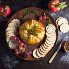 Baked Brie en Croûte With Thyme and Fig Jam; A warm, gooey wheel of brie or camembert cheese, topped with sweet fig jam and wrapped in golden brown, flaky puff pastry.  Offering maximum impact with…