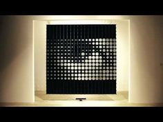 Created by Korean collective HYBE, IRIS is a media canvas with matrix of conventional information display technology, that is a monochrome LCD.Through the phased opening and closing of circular black liquid crystal, IRIS can create various patterns and control the amount (size) of passing lights.