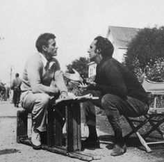 "James Dean and Timothy Carey prepare for the scene outside of Kate's house in ""East of Eden""."