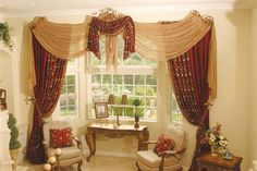 Silk fabric is suggested for bay windows. This is another idea with the 2 chairs and something in the middle. The curtains are heavy, which is offset by furniture that is more airy.. Shows how you can use the same color throughout.