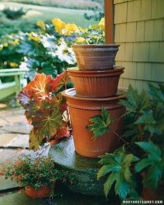 "DIY Stacked Pots Water Feature...""You don't need a lakefront property to enjoy the benefits of backyard water. Stacked pots filled with a pump and filled to the brim produce sounds reminiscent of lapping waves"". (Martha Stewart)"