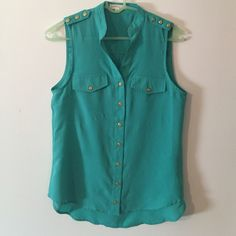 Teal sleeveless button up blouse Teal sleeveless button up blouse. Top is a Size M, I usually wear a size S and this fits nice and flowy like I wanted it to! High-low style top, looks cute with white jeans! Tops Tank Tops