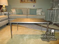 """Gorgeous metal coffee table in a light bronze with a dimpled finish down the legs. Love the sleek lines! Ideal for a contemporary space. This is a solid piece as well, good weight to it. 36""""long x 22""""deep x 18""""high. Arrived: Friday December 30th, 2016"""