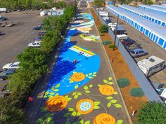 This street mural in Aurora, Colorado, was created in four days in August and September with 350 volunteers, 180 gallons of paint, and is two blocks long! It was designed by Yulia Avgustinovich. It is one of the biggest murals in Colorado!