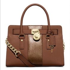 Michael Kors Hamilton E/W Satchel Bag Color: Luggage/Copper  Details: This structured east west satchel features a metallic stripe and bold gold-tone hardware for the ideal look. Transform your collection with this essential accessory. 13-in. W x 9-in. H x 5.5-in. D Magnetic closure Interior: 4 slip pockets, 1 back wall zip pocket Double handles; adjustable/removable strap Gold-tone hardware; self-color stitch trim Saffiano leather. NWT Michael Kors Bags Satchels