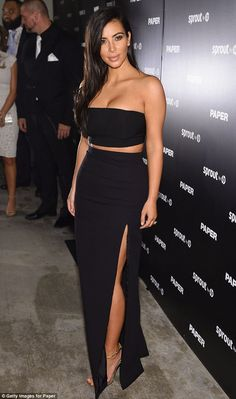 Letting her dress do the talking: Kim added some glitz with strappy gold heels but kept th...