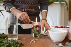 Partnering with Kaufmann Mercantile and The Meatball Shop, we've made the cutest holiday crafts that will make your place look holiday ready (but with minimal effort). Christmas Tablescapes, Christmas Table Decorations, Cranberry Tea, Christmas Fun, Xmas, Diy Candles, Holiday Crafts, Tea Lights, Easy Diy