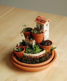 45 Magical DIY Succulent Fairy Garden Ideas https://www.decomagz.com/2017/12/12/45-magical-diy-succulent-fairy-garden-ideas/ #littlegardens #miniaturegardens