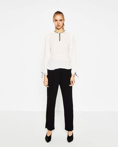 Image 1 of BLOUSE WITH CONTRAST PIPING from Zara