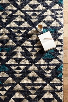 Woven Arrowhead Rug - anthropologie.com --> pretty sure nothing in my dorm is going to match, but that's fine.