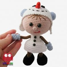 Doll in a Snowman outfit