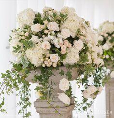 Romantic blush design in urn roses, spray roses, stock, hydrangea variegated pittosporum