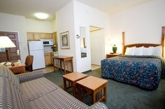 A look inside an extended stay hotel room with a kitchenette. photo by oakbrookterracehotels on Flickr
