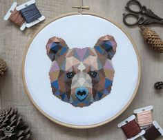 Geometric Bear Counted Modern Cross Stitch Pattern. This pattern is an instant download PDF.  Size: 92w x 92h stitches 18 Count Aida: approx. 5.2w x 5.2h inches or 13.0w x 13.0h cm 16 Count Aida: approx. 5.8w x 5.8h inches or 14.6w x 14.6h cm 14 Count Aida: approx. 6.7w x 6.7h inches or 16.7w x 16.7h cm Stitches Required: Full cross stitches Colors Required: 24 DMC floss colors  The sample was made on 18 count aida and framed in a 8 hoop.  PDF Included: - Pattern in color symbols with floss…