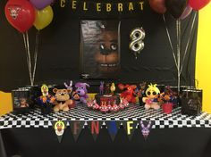 FNAF ( Five Nights At Freddys ) theme birthday decor. I did this for my son and he loved it. Credit to me :)