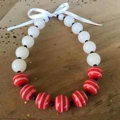 A personal favorite from my Etsy shop https://www.etsy.com/listing/468702196/chunky-red-and-white-bubblegum-necklace