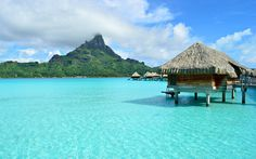Bora Bora, where thatched-roof bungalows spider out into the shallows on sturdy wooden piers. Description from aswglobalist.com. I searched for this on bing.com/images