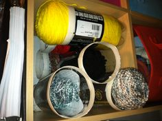 Yarn storage in 2-liter bottles. Love it grab and go!