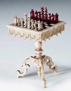 Rare German carved bone 19th century Miniature Chess Table and Men. These fascinating miniature items were made in Geislingen, a noted German carving centre. A very similar example was on exhibition at the Schach Partie durch Zieten und Welten in the Museum fur Kunst und Gewerbe, Hamburg, Germany
