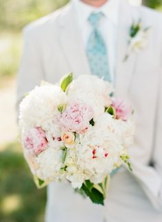 Soft & elegant hydrangea, ranunculus and peony bouquet: http://www.stylemepretty.com/north-carolina-weddings/belhaven/2015/08/31/coastal-elegance-inspired-wedding-in-north-carolina/ | Photography: Faith Teasley - http://faithteasley.com/