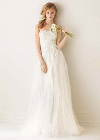 Romantic and airy, you will be able to envision your walk down the aisle in this dreamy pleated Organza wedding dress!  Strapless A-line bodice features glamorous beaded lace appliques.  Pleated organza skirtdetailprovides an eye-catching and breathtaking look.  Tulle overlay adds movement and dimension while creating a stunning silhouette.  Sizes 0-26. Sweep train. Available in Ivory.  Woman: Style MS251062. Sizes 16W-26W.  (Special Order Only).  Fully lined. Back zip. Imported ...