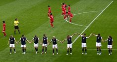 The U.S. women's team does the worm after scoring against North Korea. (AP)
